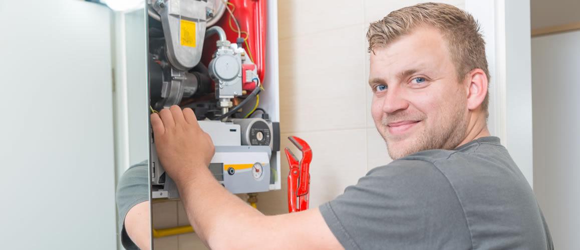 man repairing boiler