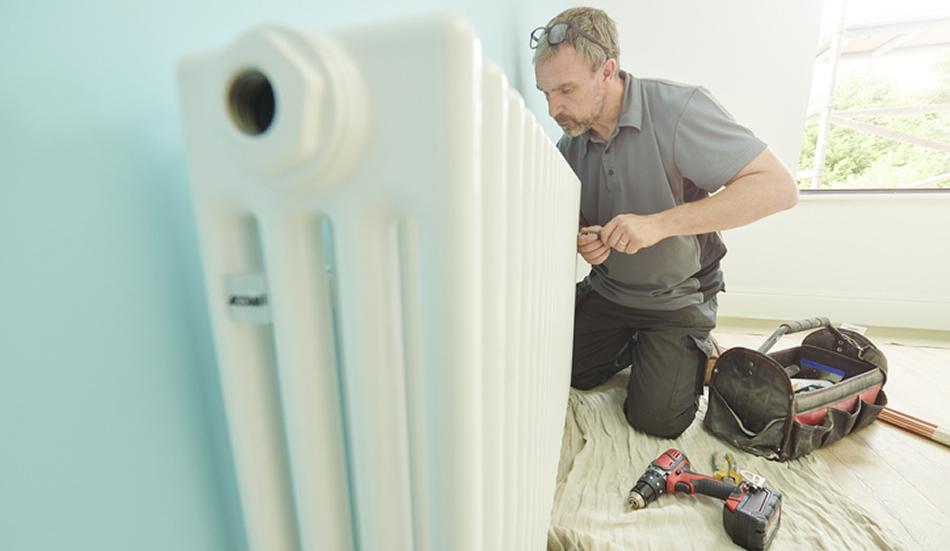 Man working on a radiator